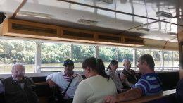 A képen az látható, amint a tagjaink egy része a hajóban ülnek