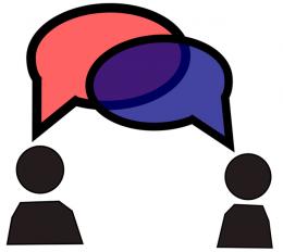 A képen két beszélgető ember látható.